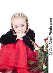 Cute girl with christmas tree