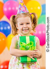 girl with colorful balloons and gift
