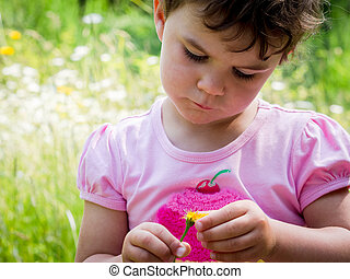 Cute girl with flower in pink