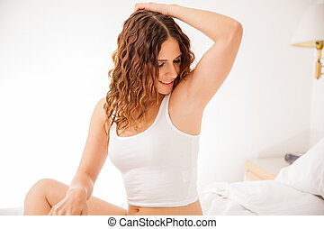 Happy young brunette showing off her recently depilated and smooth armpits