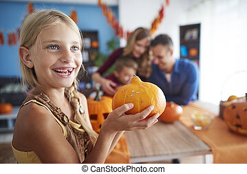 Cute girl with Halloween pumpkin