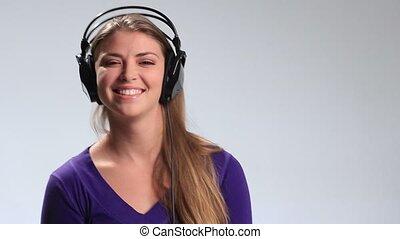 Cute girl with headset having fun listening music