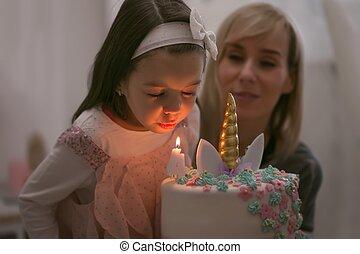 Cute girl with long hair has his 4th birthday