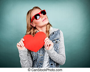 Cute girl with red heart