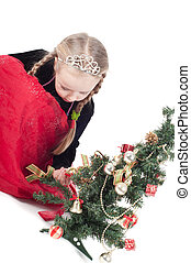 Cute girl with small christmas tree