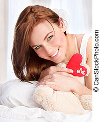 Cute girl with soft bear toy