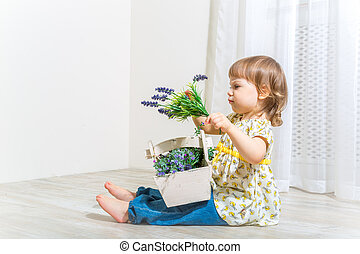 Cute girl with spring flowers