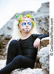 Cute girl with sugar skull makeup