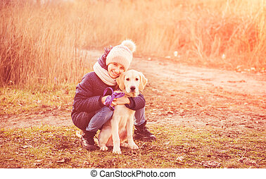 Cute girl with young dog