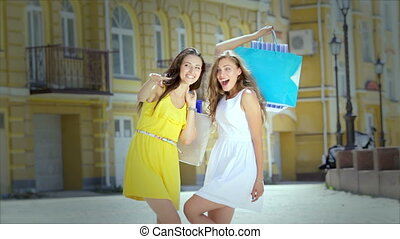 Cute girls emotionally greet their friends while shopping