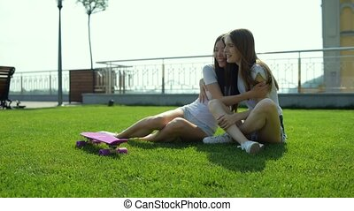 Cute girls enjoying wonderful rest in the nature -...