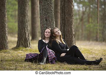Cute girls friends sitting