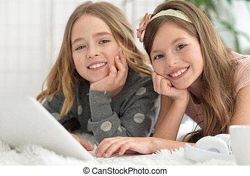 Cute   girls  in   with laptop