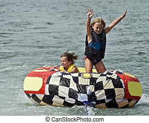 Cute Girls on Tube Behind Boat