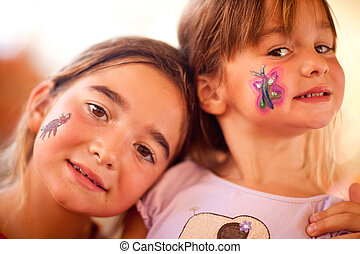 Cute Girls Showing Their Face Painting At A Party
