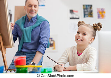 Cute grandparent and child are drawing with joy - Cheerful...