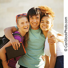 cute group of teenages at the building of university with...