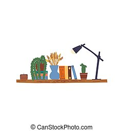 Cute hand drawn wooden book shelf and two home plants, cactus and dischidia in pots, vase with decorative dried grass bunches, various books, table lamp and aroma candle in glass.