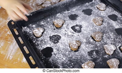 Cute hands making heart shaped cookies
