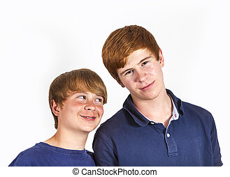 cute handsome brothers having fun together - portrait of...