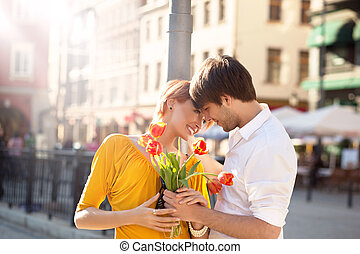 Cute hansome couple on date with flowers
