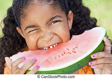 Cute Happy African American Girl Child Eating Water Melon