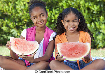 Cute Happy African American Girls Children Eating Water Melon