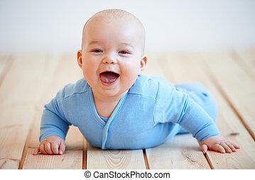 Cute happy baby boy crawling on the floor - Cute happy baby...