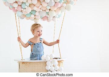 happy baby boy in a fairy magic hot air balloon