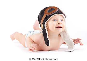 cute happy baby boy in diaper and pilot hat