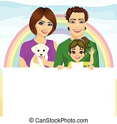 happy family with pet dog holding a white blank billboard in front of rainbow