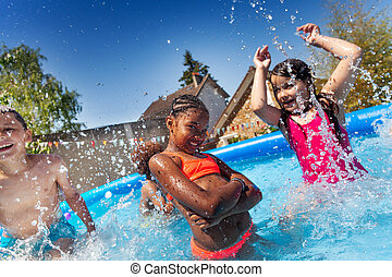 Cute happy girl pose with friends in the pool