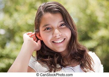Cute Happy Hispanic Girl in the Park