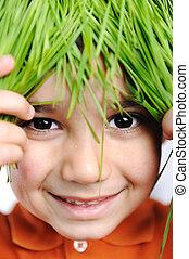 Cute happy kid with grass hair