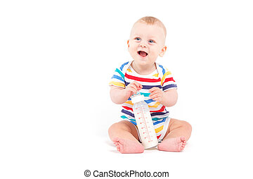cute happy little boy in colorful shirt with milk