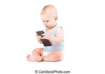 cute happy little boy in speckled shirt with cellphone
