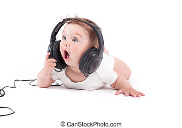 cute happy little boy in white shirt with headphones