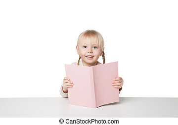 Cute happy little girl reading a book. Isolated on white background