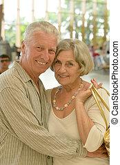 Cute happy senior couple at shopping mall