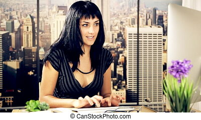 Cute happy woman at work in office