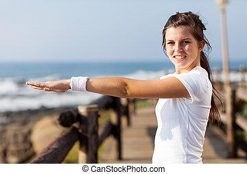 cute healthy teen girl doing morning exercise