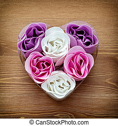 Cute heart made of fabric flowers. Symbol of love.