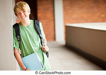 cute high school boy portrait in school