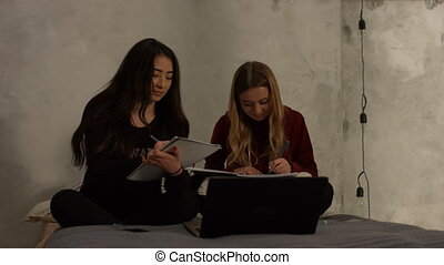 Cute high school girls studying together at home - Charming...