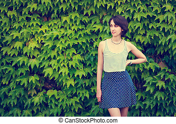 Cute Hipster Girl on Green Nature Background