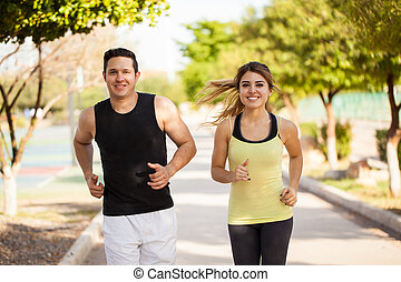 Cute Hispanic couple jogging together