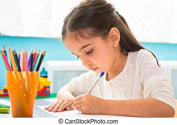 Cute hispanic girl writing at school - Cute little hispanic...