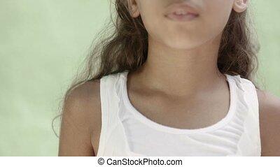 Cute hispanic little girl smiling