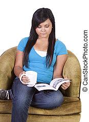 Cute Hispanic Teen Girl Reading a Book