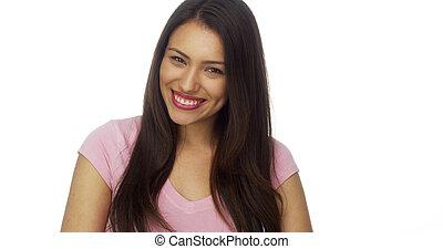Cute Hispanic woman looking at camera